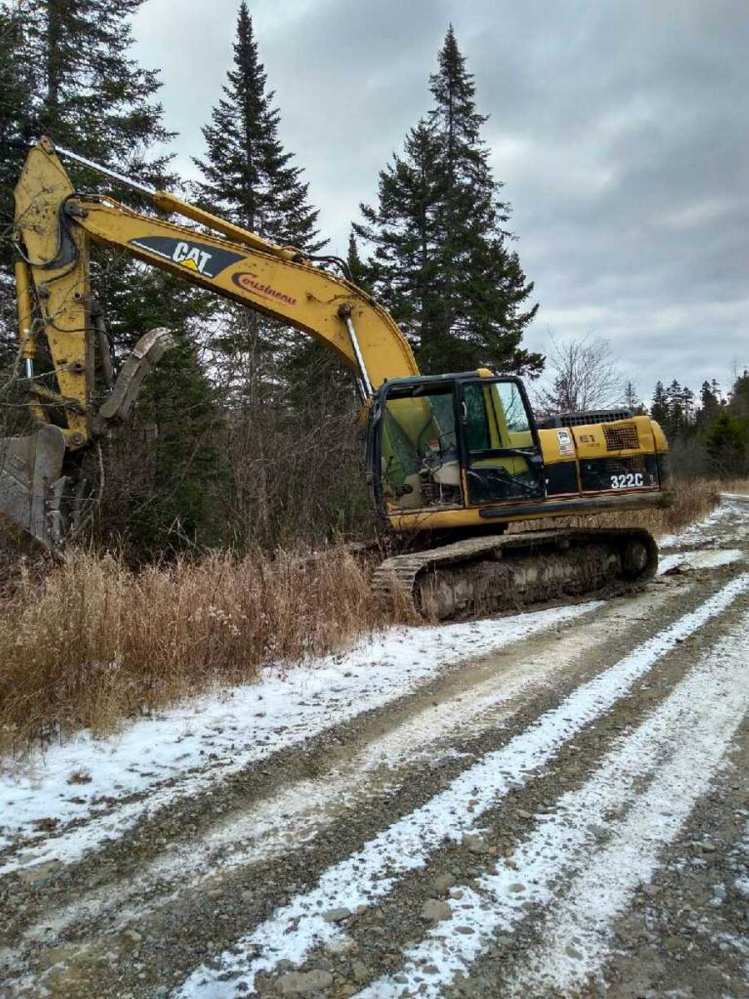 This track excavator, owned by Cousineau Inc. in Wilton and discovered Tuesday in Sandy Hill Plantation, was stolen but not damaged.