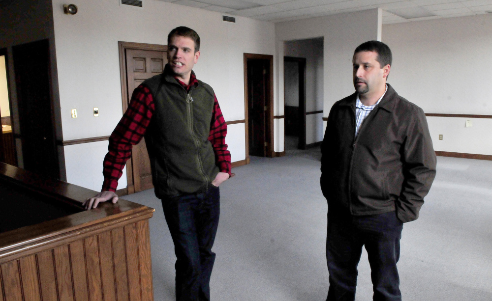 Sam Hight, left, and Matt L'Italien, the director of Somerset Public Health, said on Wednesday they expect the building at the corner of Madison Avenue and Elm Street in Skowhegan to be brought up to code and equipped with updated data lines, and to become home to the health coalition by the beginning of December.