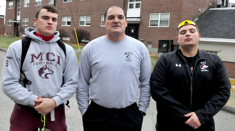 Football is all in the family for Maine Central Institute as head coach Tom Bertrand, center, is flanked by his sons, Adam, left, and Alex. Adam plays running back while Alex is an assistant coach.