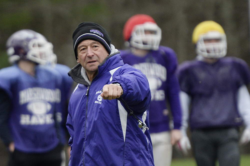 Marshwood football coach Alex Rotsko talks with his players Tuesday in South Berwick.