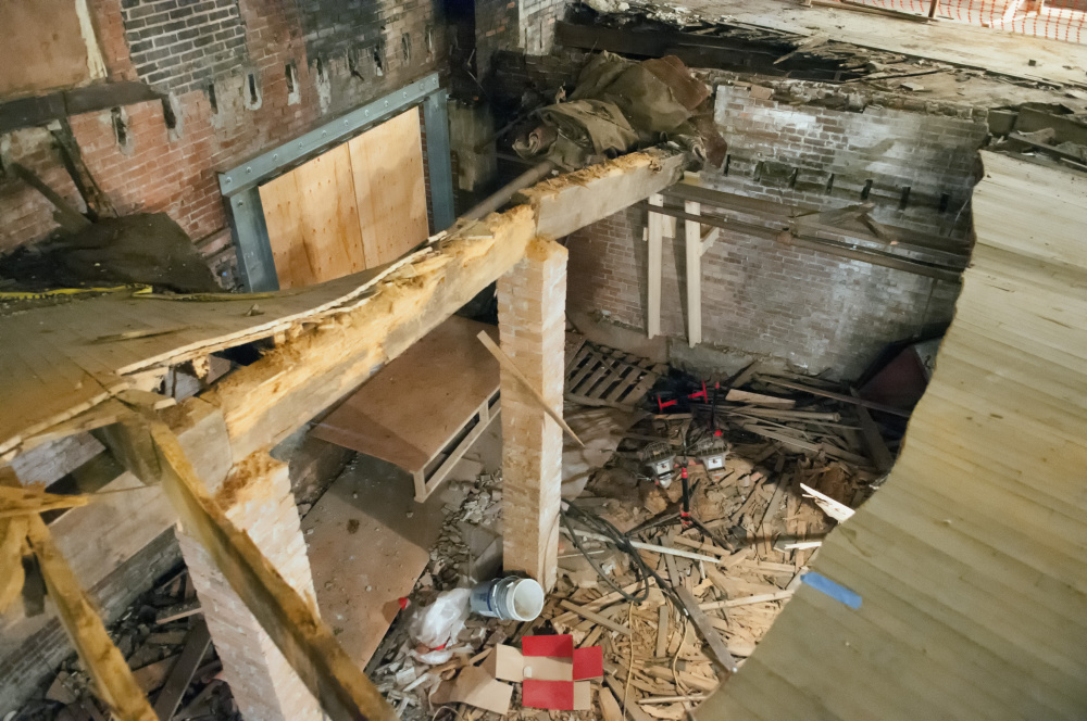 This photo taken Nov. 8 shows the inside of the Colonial Theatre in Augusta, where work to repair a hole in the floor is on hold until coal dust and asbestos can be removed from the basement.
