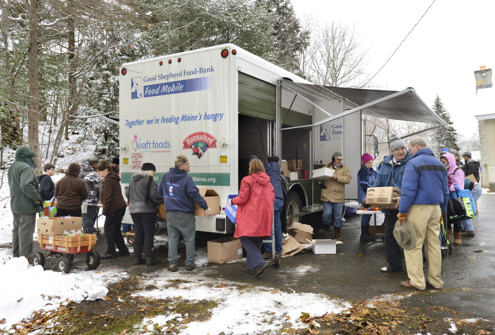 A line forms around the mobile food truck behind the Grace Episcopal Church in Bath. Tuesday, Nov.26, 2013. John Patriquin/Maine Sunday Telegram.