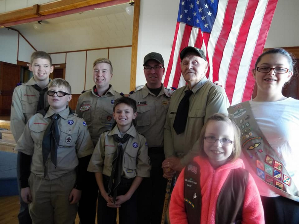 Front, from left, are Brock Stanhope, Robert Spears, Addision Poulin and Kimberly Spears. Back, from left, are Justin Bowman, Dawson Poulin, Troop 401 Scoutmaster Ryan Poulin and Korean War veteran and former Scoutmaster Larry Tibbetts.