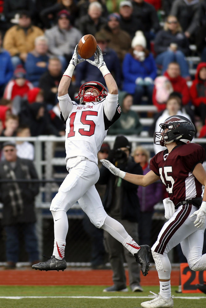Scarborough wide receiver Cody Dudley hauls in a pass as Windham linebacker defends during the Class A football championship game Saturday at Fitzpatrick Stadium in Portland.