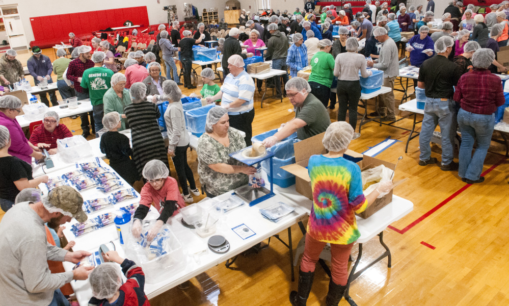Volunteers bag up fortified rice at Cony High School in Augusta in an event run by Feed My Starving Children, a Christian nonprofit organization that coordinates the packaging and distribution of food to people in developing nations.