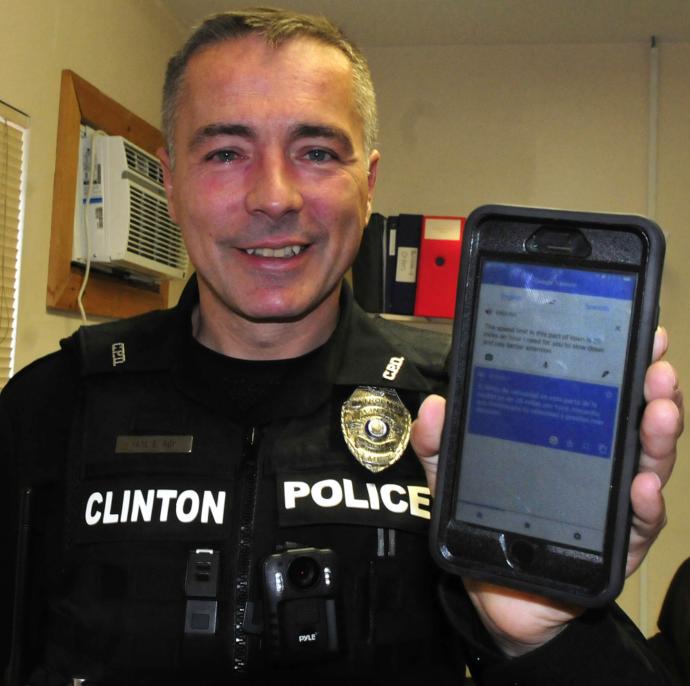 Clinton Patrol Officer Karl Roy holds his cellphone with the Goggle Translator app that he uses to communicate with a person who does not speak English.
