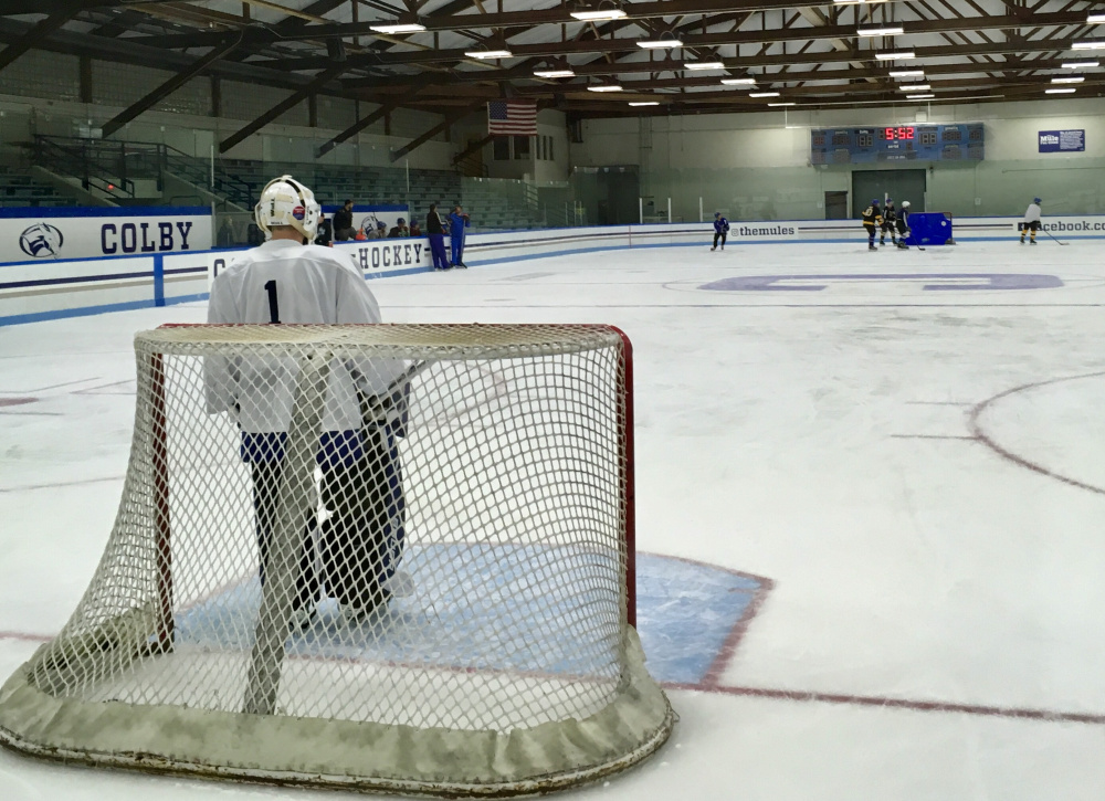 Lawrence/Skowhegan/MCI sophomore goalie Bryson Dostie watches the action during an early morning practice at Colby College on Monday.