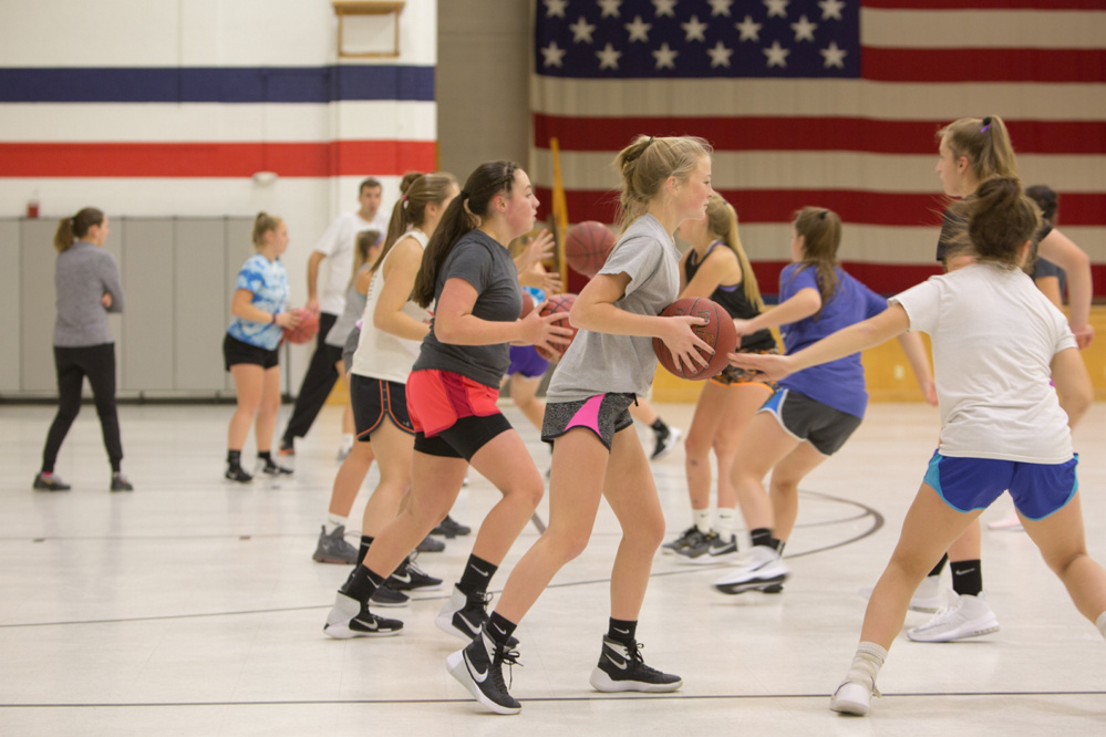 The Gardiner Area High School girls basketball team works through a drill during the first day of practice Monday at the Augusta Armory.