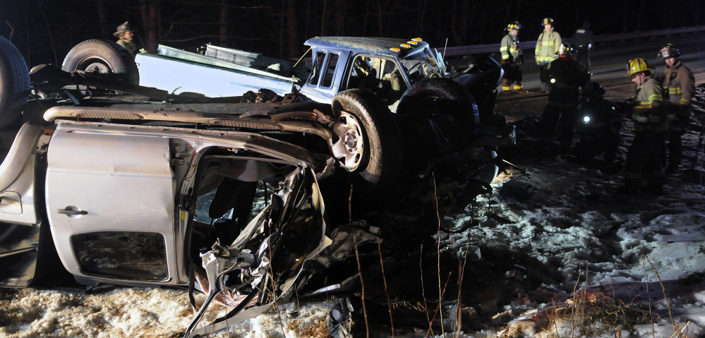 Firefighters check pickup trucks that collided on Jan. 4, 2016, on Route 9 in Chelsea, injuring three people. All the victims had to be extricated from the vehicles, police said, and to be treated for multiple life-threatening injuries.