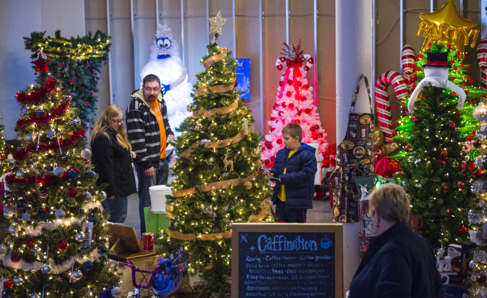 People browse among the many Christmas trees on display last Friday at the Sukeforth Family Festival of Trees at the Hathaway Creative Center in Waterville.