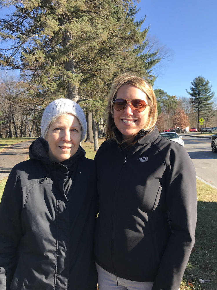 Suzanne Callahan, left, and Nicole Harbaugh pause while on a walk Tuesday in Augusta to talk about their holiday shopping habits.