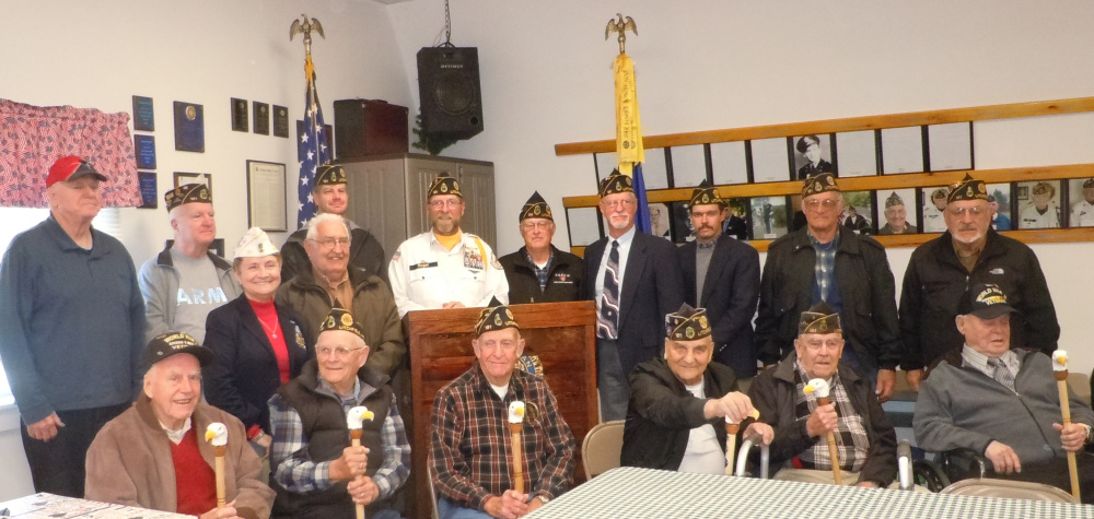 """William R. Bold American Legion Post 181, Litchfield, held a special Veterans' Day event on Nov 11. The Post honored World War II and Korean War veterans by presenting them with Eagle Canes. The canes are handmade by Donna and George Gunning and include the veteran's branch and dates of service, name, and all medals received. From left are William """"Bill"""" Quackenbush, WWII; Harold Blen, WWII; George Perry, Korea; Keith Estabrook, WWII/Korea; Malcolm Harvey, WWII/Korea/Vietnam; and Leo Small, WWII. Back from left, are Post 181 members Randall Furbish, Ron Dixon, Debra Couture, Ernie Rowe, Scott Bailey, Roger Line, Glenn Bowman, Greg Couture, Michael Sherman, Normand Bernier and Carlton Tripp."""