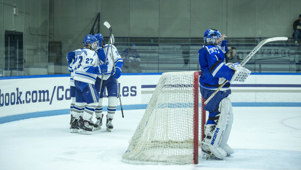 Colby College celebrates their second period goal against University of Massachusetts at Boston on Saturday at Colby College in Waterville.