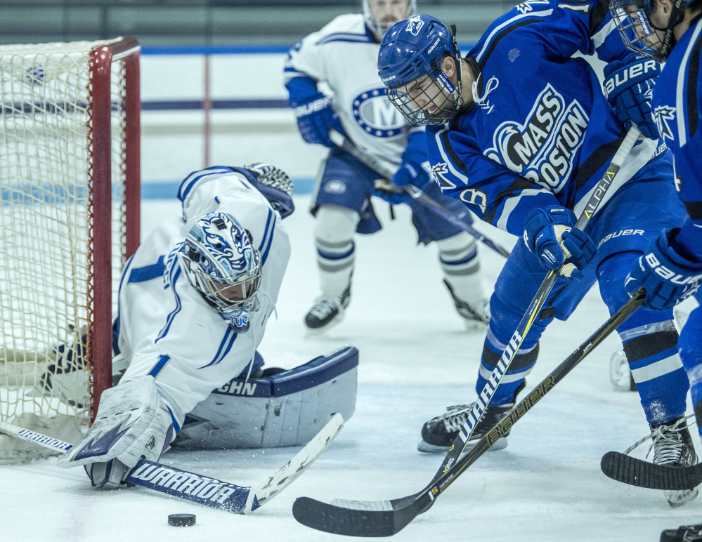 Colby College goalie Andrew Tucci makes a save against UMass Boston's Zach Bross (18) at Colby College in Waterville on Saturday.