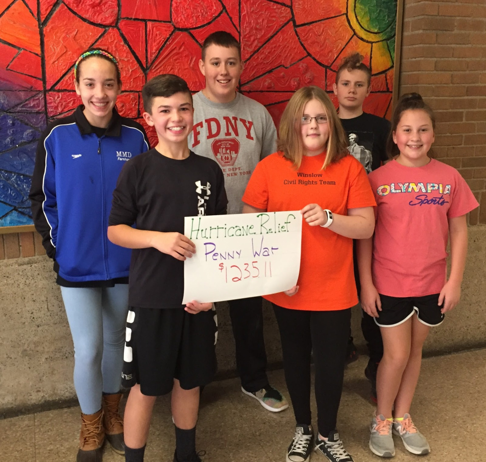 Winslow Junior High School students raised funds for families of Yes Prep Public School in Houston, which was devastated by Hurrucane Harvey. Students who organized the fundraiser in front, from left are Talon Loftus, Waverly O'Toole and Natalie Bourget. In back, from left are Emma Farnham, Joe Pfingst and Xander Giguere.