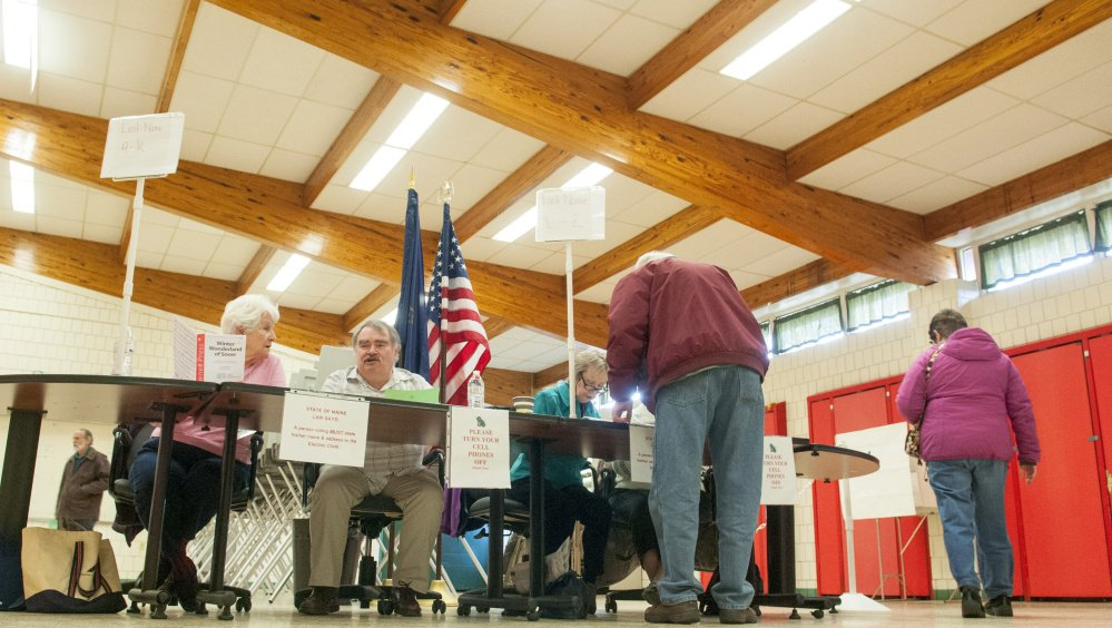 Voters come in to vote for a candidate to fill the one vacant City Council seat Tuesday at the Winthrop Town Office.