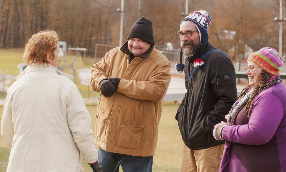 """Town Council candidates Anthony """"Andy"""" Wess, second from left, David Hughes and Faith Benedetti greet a voters Tuesday at the Winthrop Town Office."""