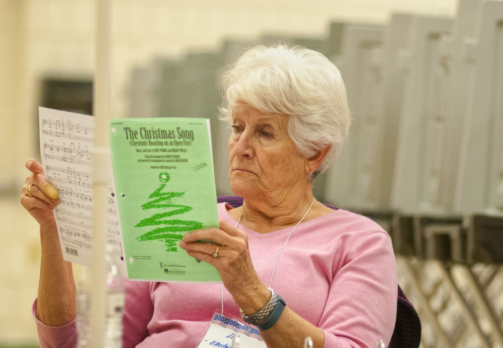 Election Clerk Lillian Stresser reviews her sheet music for a chorus while waiting for voters Tuesday at the Winthrop Town Office. Stresser is part of the CODA Chorus, which will be holding its 50th annual holiday celebration featuring two concerts at 3 p.m. and 7 p.m. Dec. 9 at Hope Baptist Church on U.S. Route 202 in Manchester.