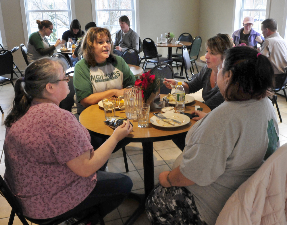 High Hopes Clubhouse Director Lisa Soucie, second from left, has lunch with members Missy Gross, left, and Barbie Smith, at far right, on Wednesday in Waterville. Also having lunch is assistant director Candy Lessard, second from right. The organization has been recognized for having 79 percent of its members employed.