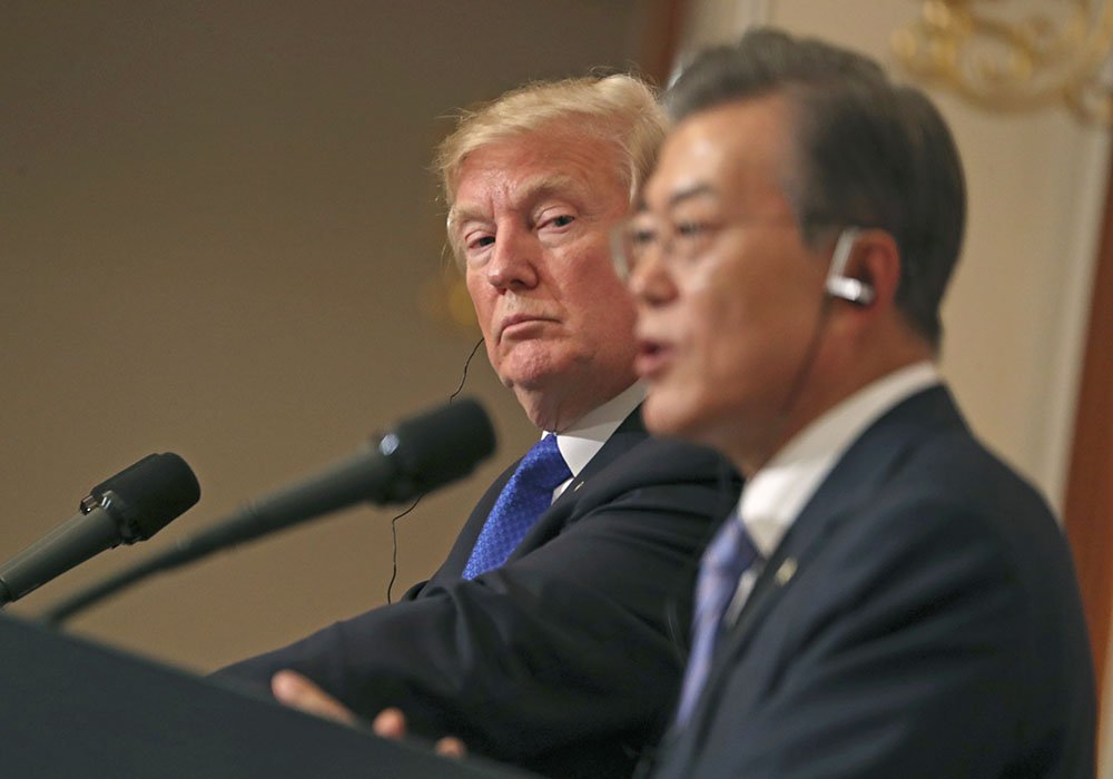 President Trump listens to South Korean President Moon Jae-in during a joint news conference in Seoul, South Korea, Tuesday.