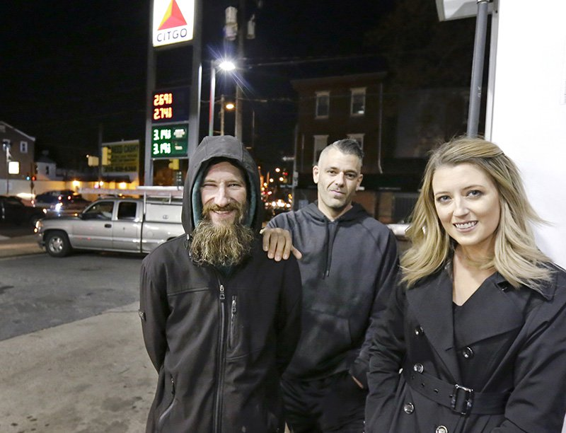 Johnny Bobbitt Jr., left, Kate McClure and McClure's boyfriend Mark D'Amico, in Philadelphia.