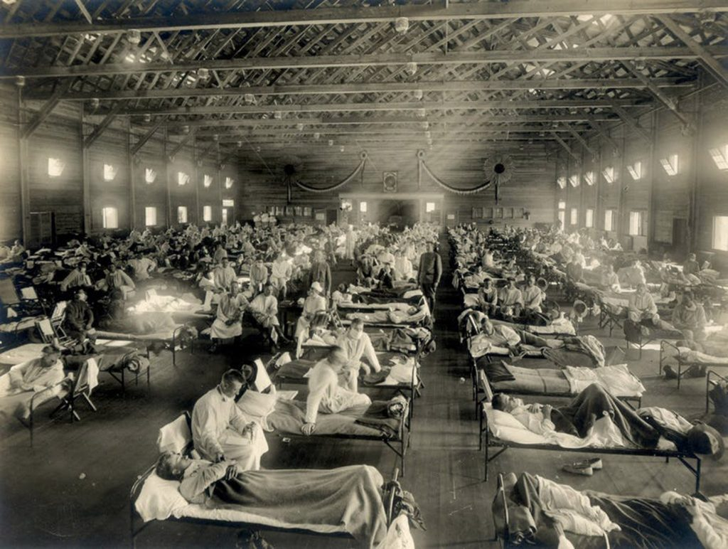 Patients fill beds in an emergency hospital in Camp Funston, Kansas, during the influenza epidemic around 1918.