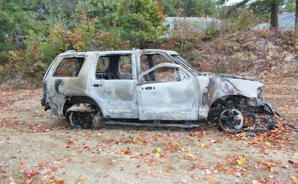 Police found the burned wreckage of the robbery victim's Ford Explorer in New Gloucester, three days after it was stolen.
