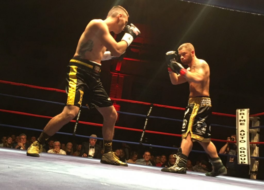 Eric Palmer, right, of Uniontown, Pennsylvania, stands across from West Forks boxer Brandon Berry during their welterweight contest Saturday at the Portland Expo.