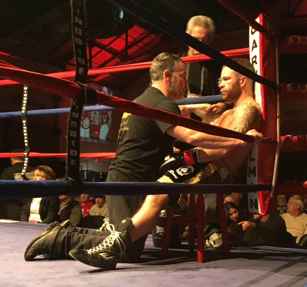 Brandon Berry, right, gets instructions between rounds during his bout with Eric Palmer of Uniontown, Pennsylvania, at the Portland Expo Saturday night.