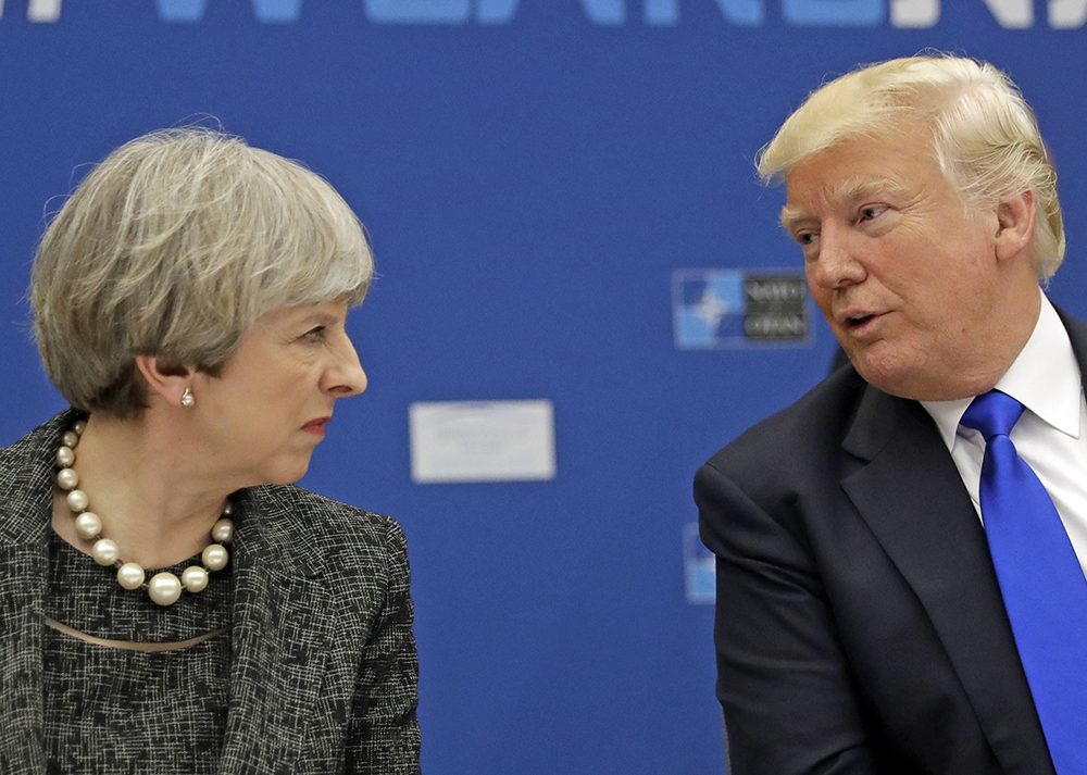 President Trump speaks with British Prime Minister Theresa May during a working dinner at the NATO  summit  in Brussels on May 25, 2017.
