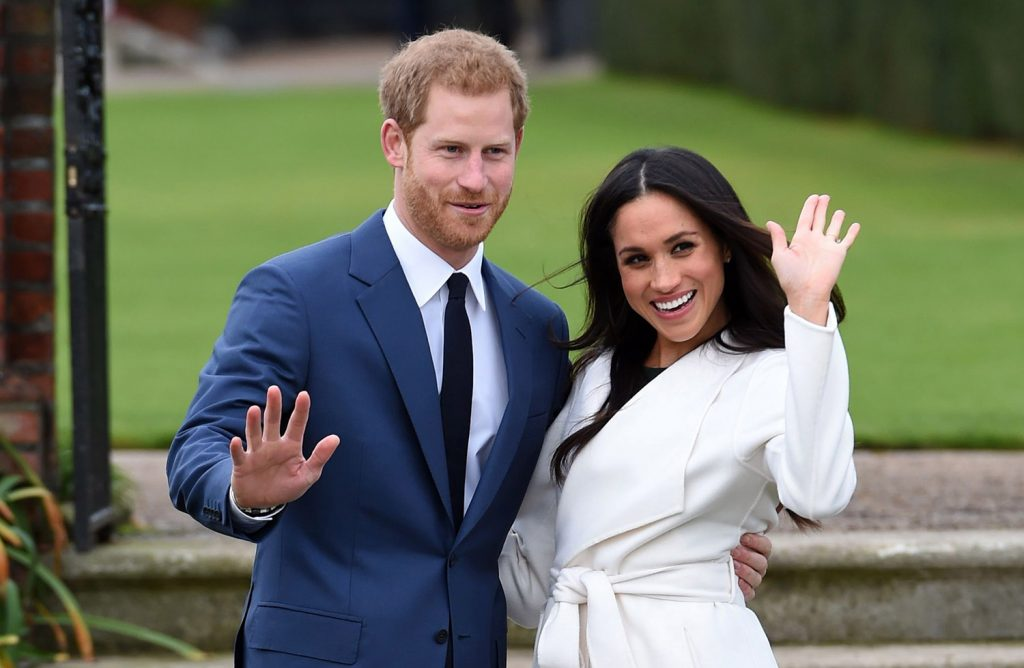 Britain's Prince Harry and Meghan Markle pose for the media on the grounds of Kensington Palace in London on Monday. It was announced that they will marry.