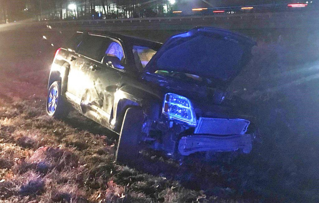 Maine State Police say Michael Messier crashed this SUV crashed at the Saco exit of the Maine Turnpike before fleeing into woods and leaving a toddler in the vehicle.