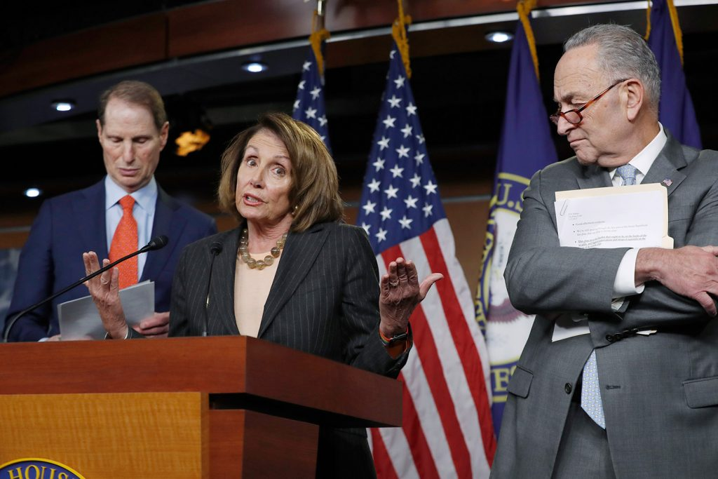 House Minority Leader Nancy Pelosi, D-Calif., and Senate Minority Leader Chuck Schumer, D-N.Y., right, pulled out of a meeting with top Republicans and President Trump on Tuesday after Trump tweeted before the meeting that he couldn't see making a deal to keep the government open. At left is Sen. Ron Wyden, D-Ore., the ranking member of the Senate Finance Committee.