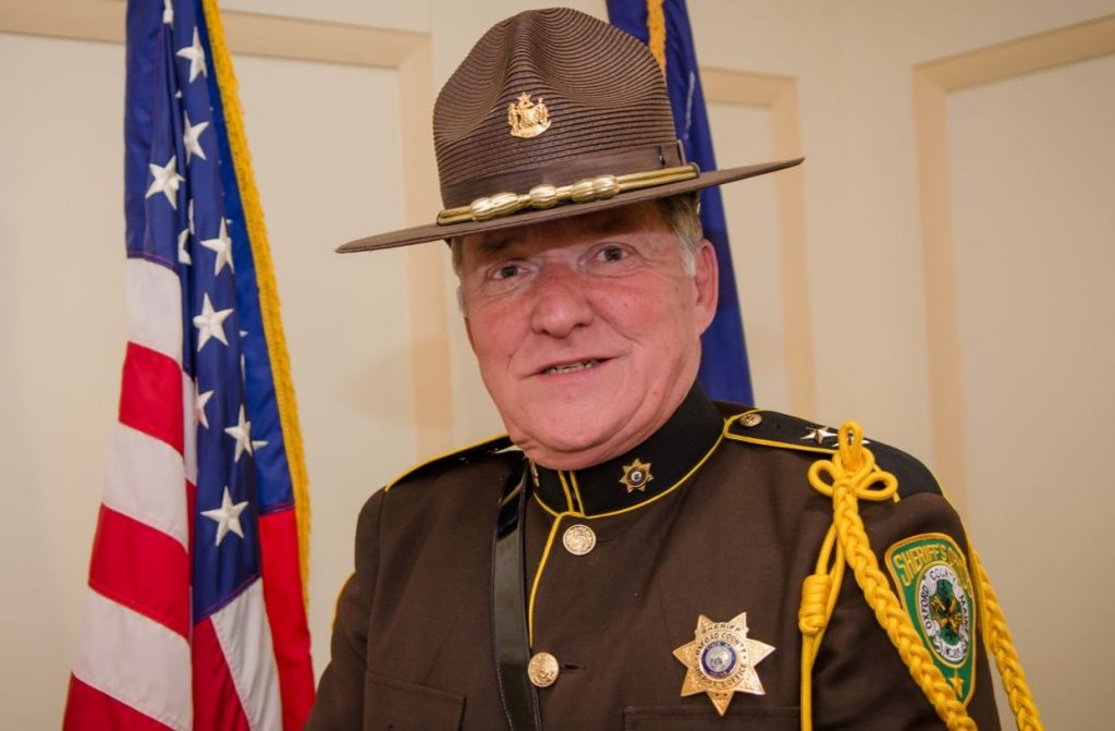 Oxford County Sheriff Wayne Gallant admitted that he had sent a sexually explicit photograph several years ago to a woman he did not identify, and announced he was resigning as president of the Maine Sheriff's Association. He is also accused of propositioning two of his employees for sex.