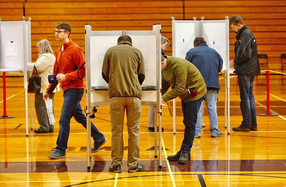 Long lines keep the Deering High School voting booths bustling in Portland on November 8, 2016. Mainers will decide on several high-profile statewide and local ballot questions this Tuesday.