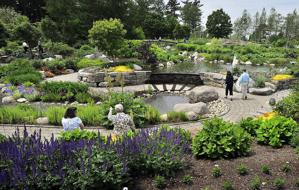 Visitors sit and walk in the Lerner Garden of the Five Senses at the Coastal Maine Botanical Gardens in Boothbay in 2016. The 300-acre attraction first announced its plans to expand in late 2015.