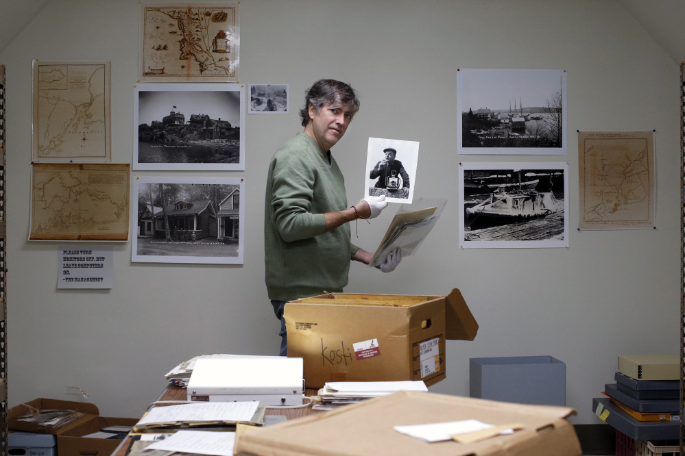 Kevin Johnson, photo archivist for the Penobscot Marine Museum, holds what is believed to be a self-portrait of Kosti Ruohomaa with his Linhof camera in Rockland in 1958.