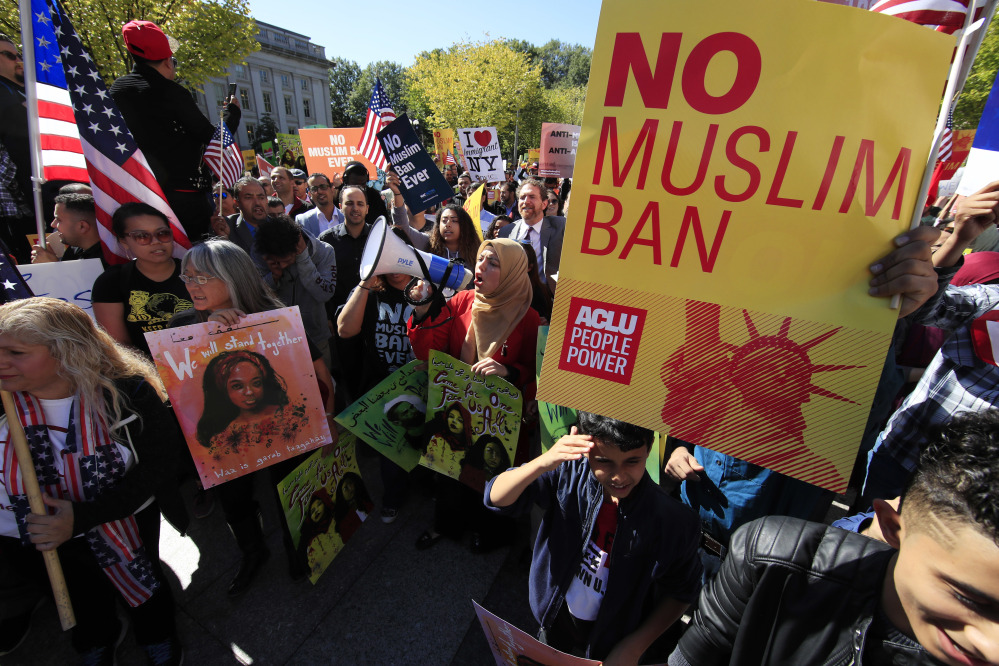 Protesters gather at a rally in Washington in October. The Supreme Court Monday voted to allow the Trump administration to fully enforce a ban on travel to the United States by residents of six mostly Muslim countries.