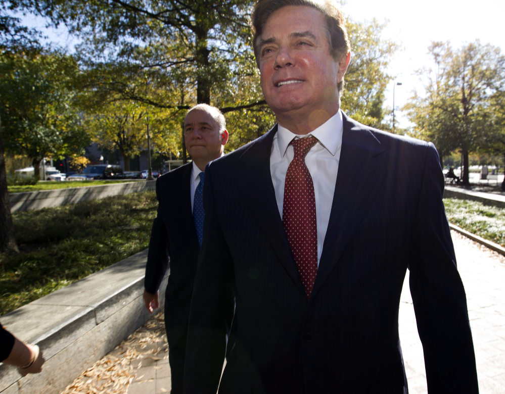 "Paul Manafort arrives at federal court in Washington on Nov. 2. Prosecutors working for Special Counsel Robert Mueller say Manafort has been working on an editorial with a long-time colleague ""assessed to have ties"" to a Russian intelligence service."