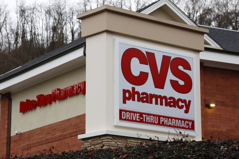 FILE - This Wednesday, Jan. 18, 2017, file photo shows a CVS Pharmacy in Pittsburgh. CVS Health, the second-largest U.S. drugstore chain, is buying Aetna, the third-largest health insurer. The evolution won't happen overnight, but in time, shoppers may find more clinics in CVS stores and more services they can receive through the network of nearly 10,000 locations that the company has built. (AP Photo/Gene J. Puskar, File)