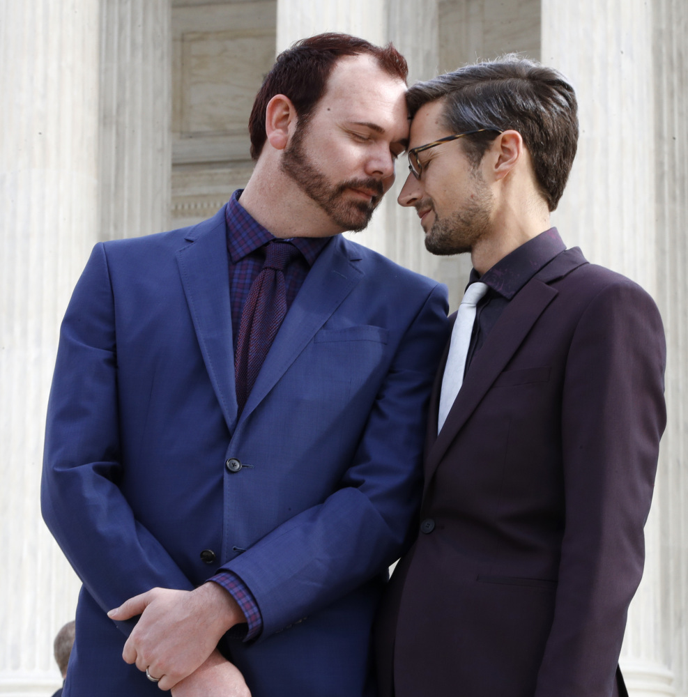 Charlie Craig, left, and David Mullins touch foreheads Tuesday after leaving the U.S. Supreme Court, where their case was heard.