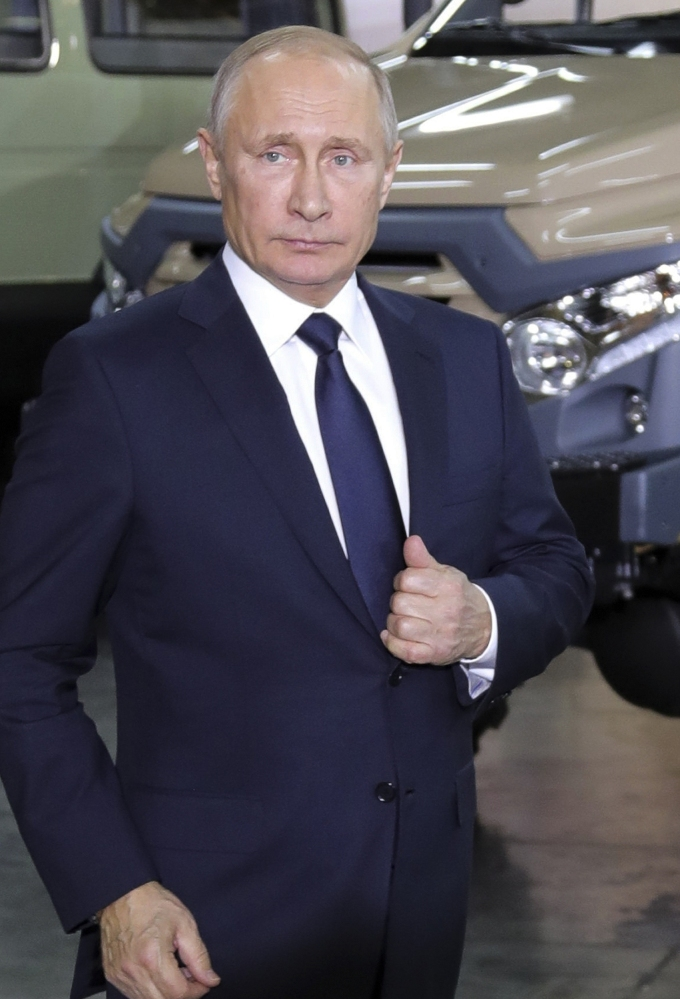 Russian President Vladimir Putin at the auto factory where he unveiled his plans.
