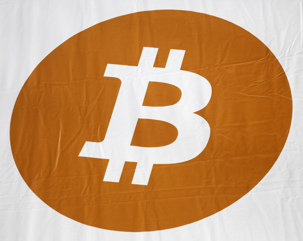 A bitcoin logo is displayed at the Inside Bitcoins conference and trade show in New York.