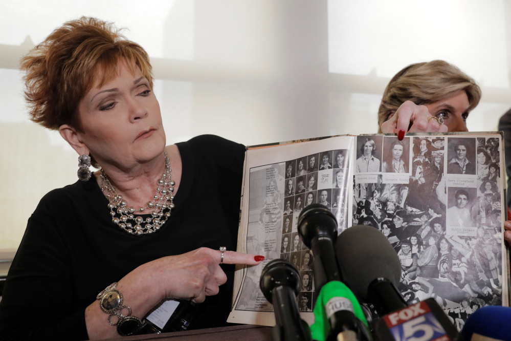 Beverly Young Nelson points to her high school yearbook last month after accusing Roy Moore of sexually assaulting her when she was 16. Moore had signed her yearbook, but she herself added some notes after his inscription, a fact that she clarified on Friday.