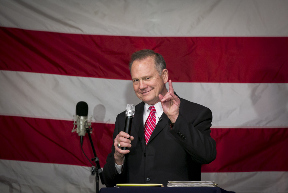 Roy Moore, Republican candidate for Senate from Alabama, speaks at a campaign rally in Fairhope, Ala., on Tuesday.
