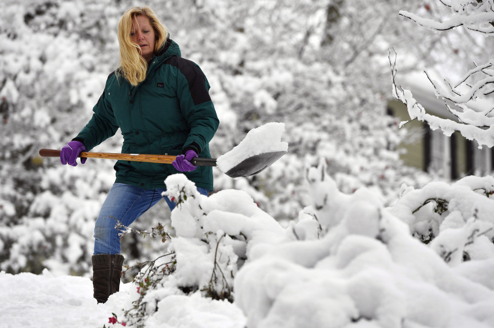 Laura Washington shovels her walk after a heavy snow Saturday in Kennesaw, Ga. The frigid temperatures behind a cold front combined with moisture off the Gulf of Mexico to bring unusual wintry weather to parts of the South.