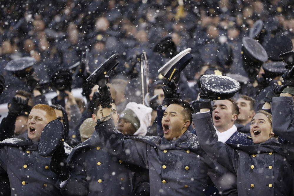 Army Cadets cheer during during Saturday's college football game against Navy in Philadelphia. Army held on for a 14-13 win.