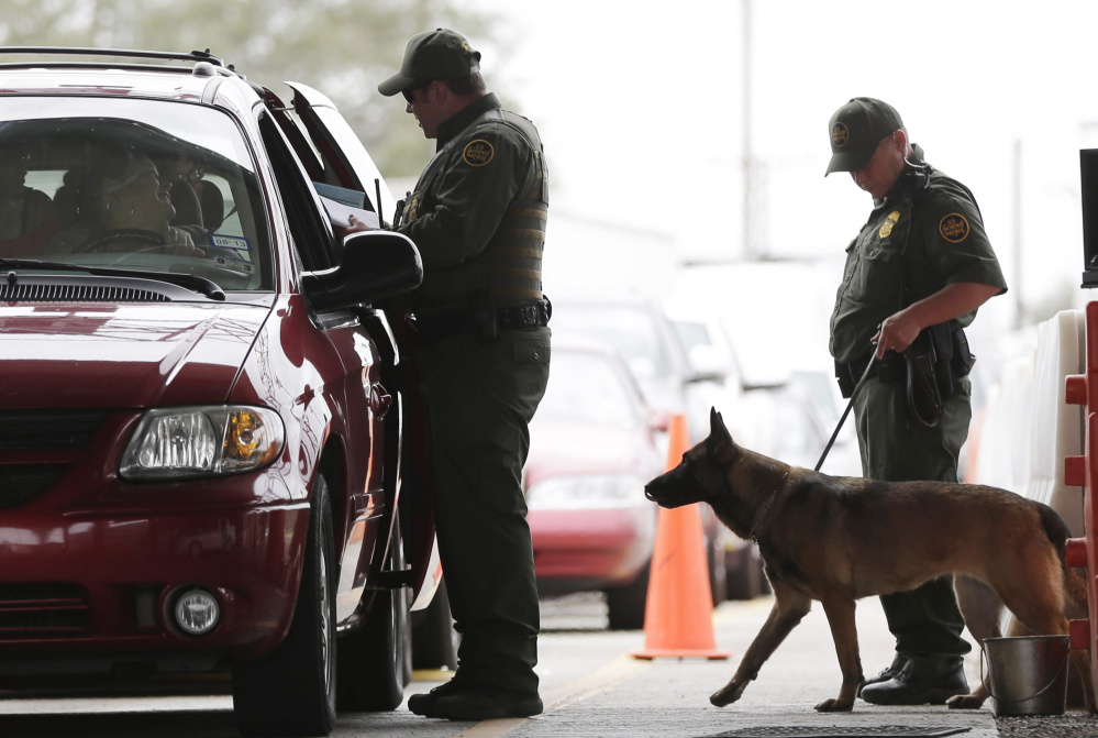 "U.S. Customs and Border Patrol agents at a checkpoint station in Falfurrias, Texas. President Trump says he wants to make legal immigration a ""merit-based"" system."