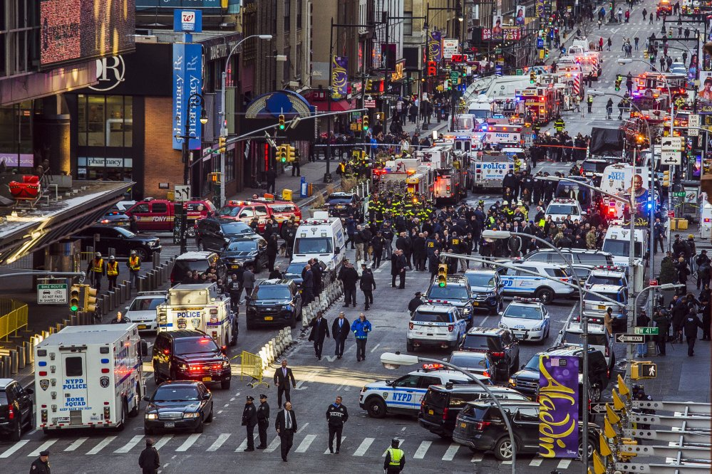 Law enforcement officials work following an explosion near New York's Times Square on Monday.