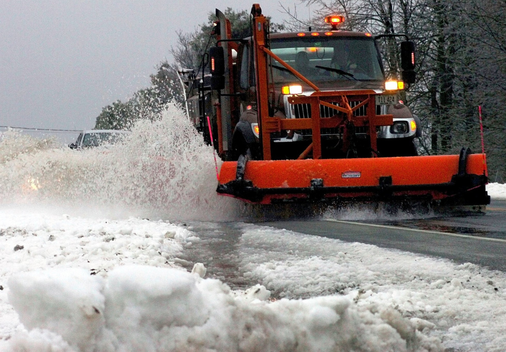 A Maine Department of Transportation plow truck driver clears Route 139 in Unity. The department currently has about 50 openings. Although the state offers good benefits, some drivers might be attracted to the better wages they can make in the private sector.